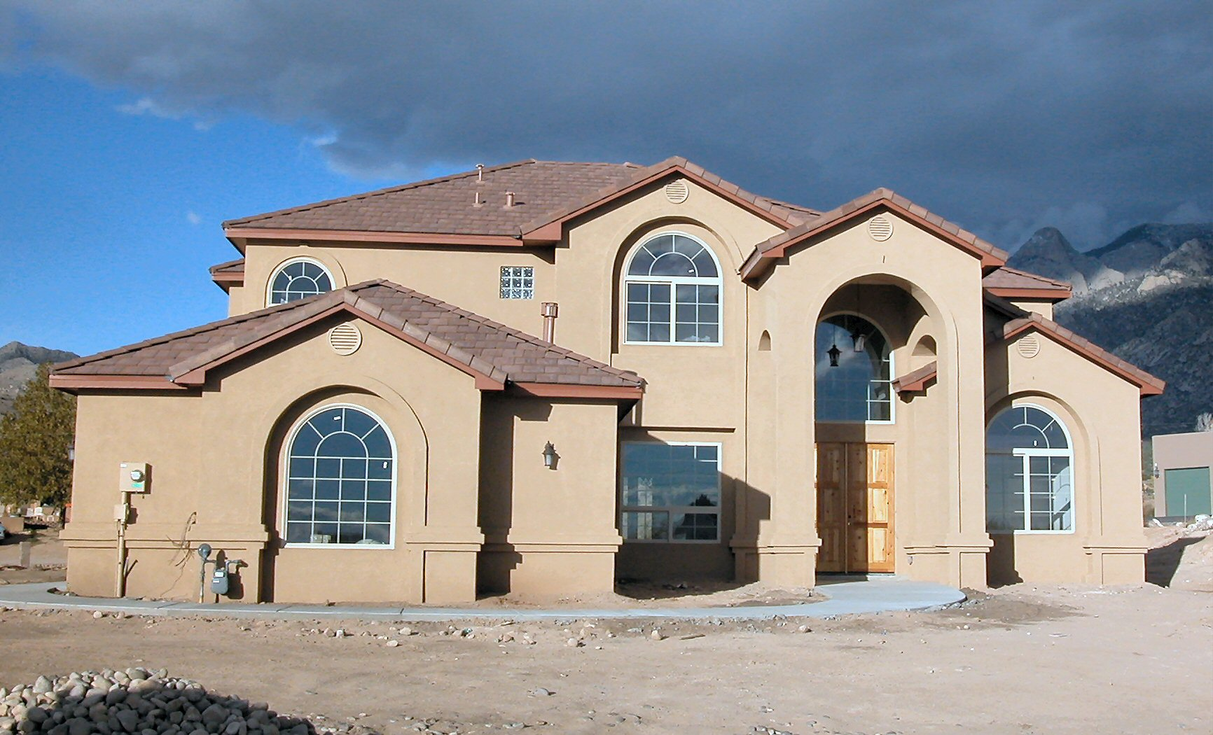 Exterior custom home views lee michael homes custom for Home builders in new mexico